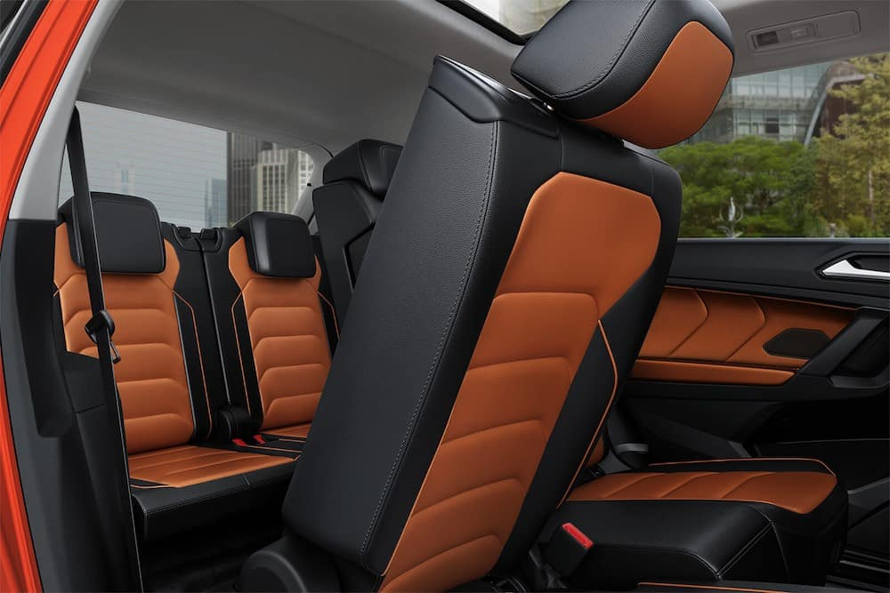 2019 Volkswagen Tiguan front and rear seats in black and orange leather