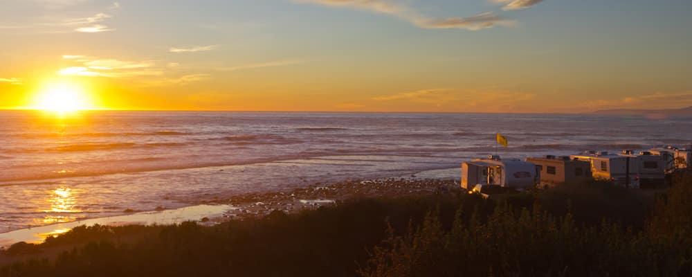 RVs on the beach at sunset