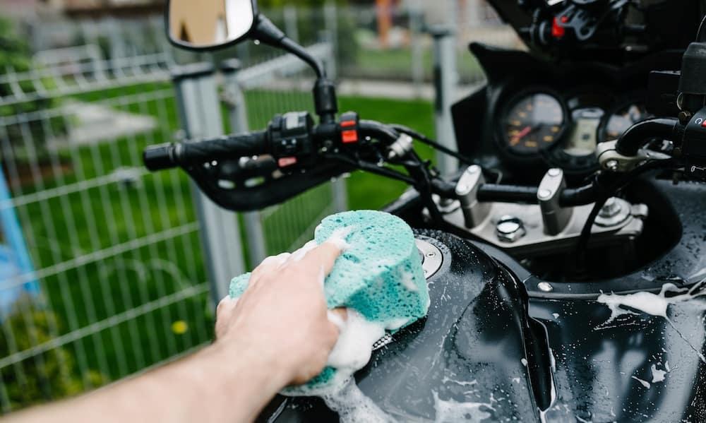 Hand Washing Motorcycle with Sponge