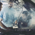 Men looking at car engine because it is overheating