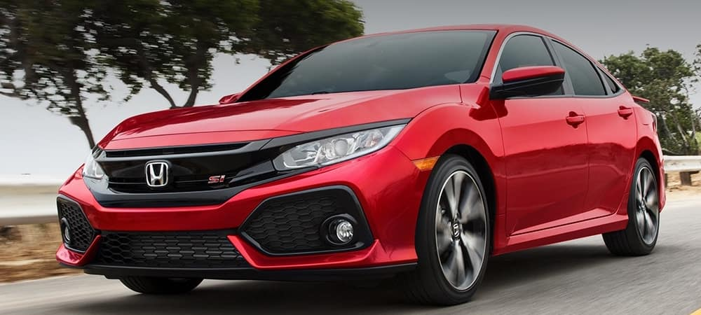 red 2019 Honda Civic SI driving on road