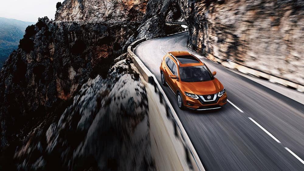 2018 Nissan Rogue Driving Through the Mountains