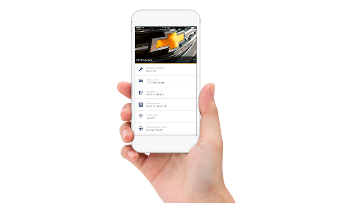 Hand holding mobile phone with Chevy Onstar mobile app