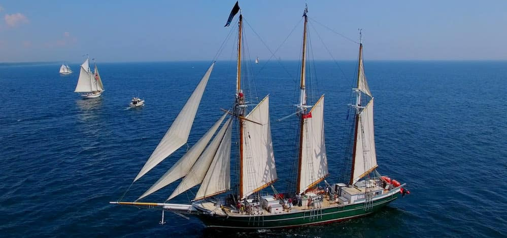 Tall ships sailing in water at Port of Call Buffalo