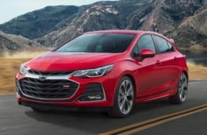Chevrolet Cruze driving through mountains
