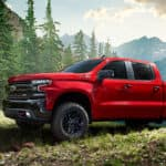 silverado special editiom truck in red driving in the fores