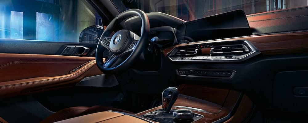 2019 bmw x5 interior with tan leather seating and wood trim