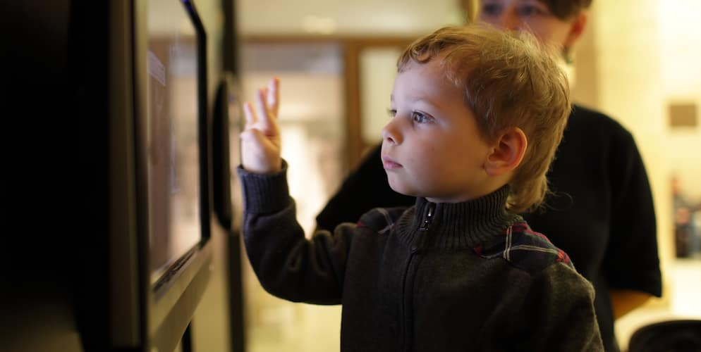 Child Using Touchscreen at Museum