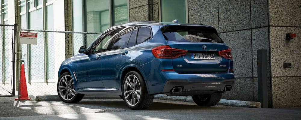 2019 bmw x3 in blue parked in city