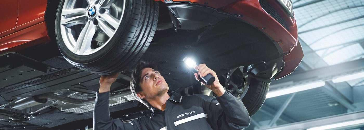 BMW Mechanic Under Vehicle