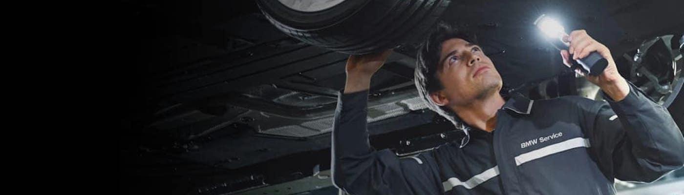 BMW Technician Looking Under Vehicle