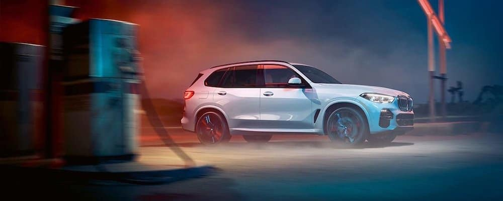 silver 2019 bmw x5 parked at gas station on foggy night