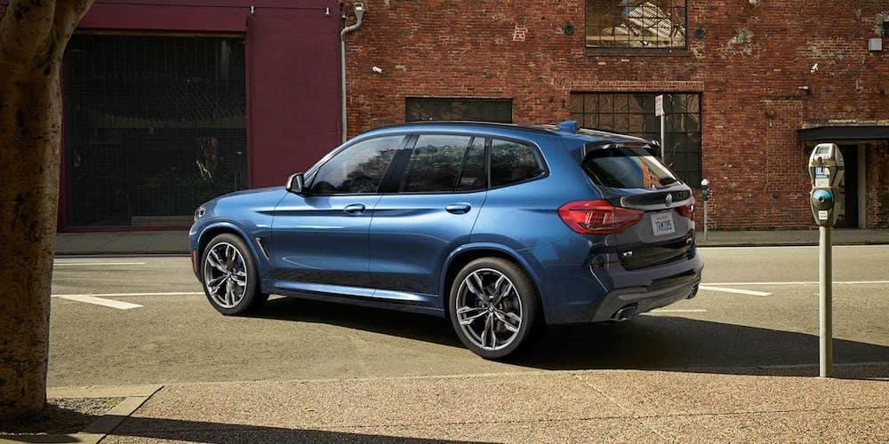 Blue 2019 BMW X3 Parking on City Street