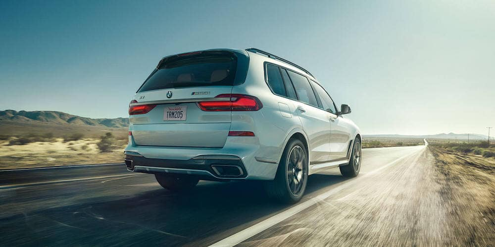 White 2020 BMW X7 Driving Down Highway