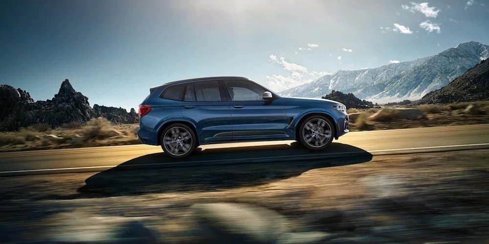 Blue 2020 BMW X3 on Highway