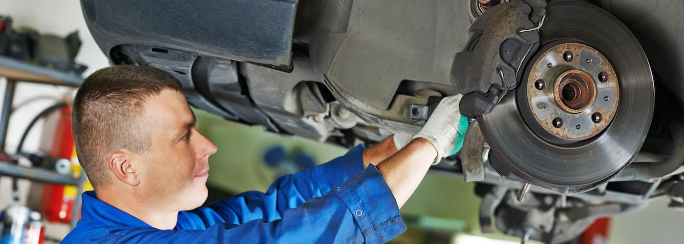 Mechanic Repairing Suspension
