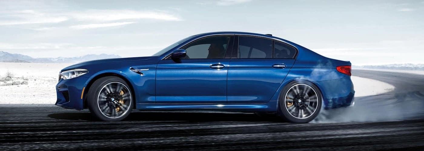Blue 2020 BMW M5 Sedan on Track