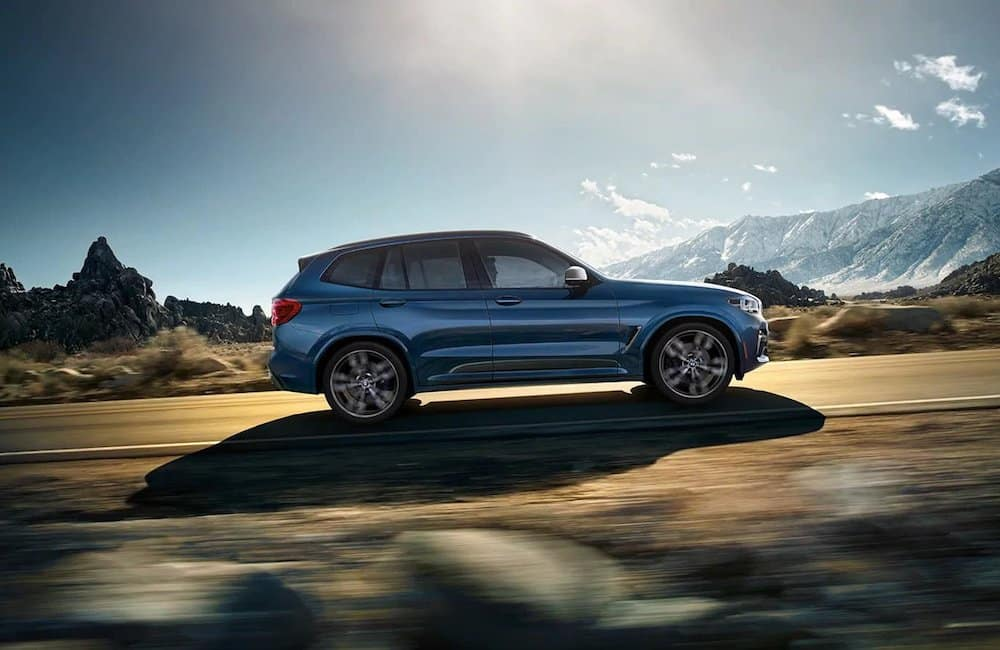 Blue 2020 BMW X3 on Mountain Highway