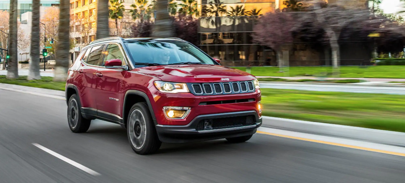 2021 Jeep Compass driving down the road.