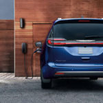 The 2021 Chrysler Pacifica Hybrid charging at home.