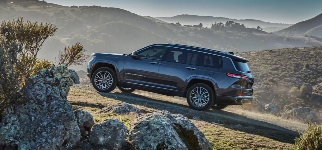 The 2021 Jeep Grand Cherokee L scaling up a steep hill.