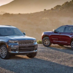 Two 2021 Jeep Grand Cherokee L models parked in the desert.