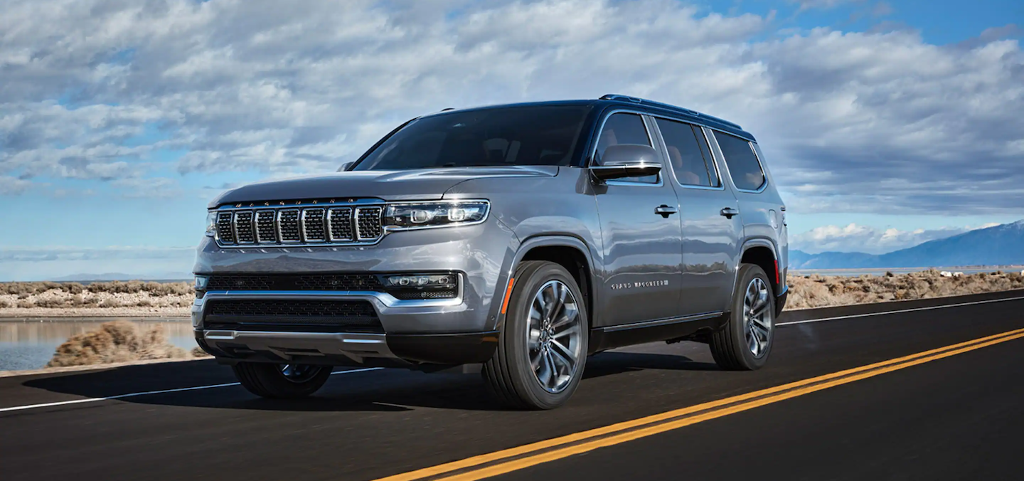 The 2022 Jeep Grand Wagoneer driving down a highway near Nashua.