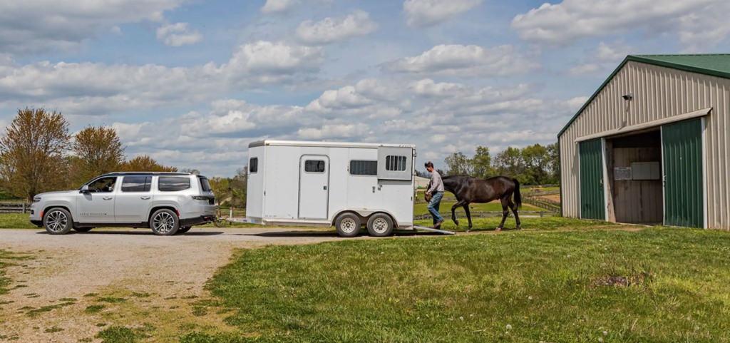 The 2022 Jeep Grand Wagoneer towing a horse near Nashua.