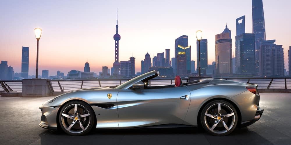 Ferrari Portofino M parked in front of a city skyline