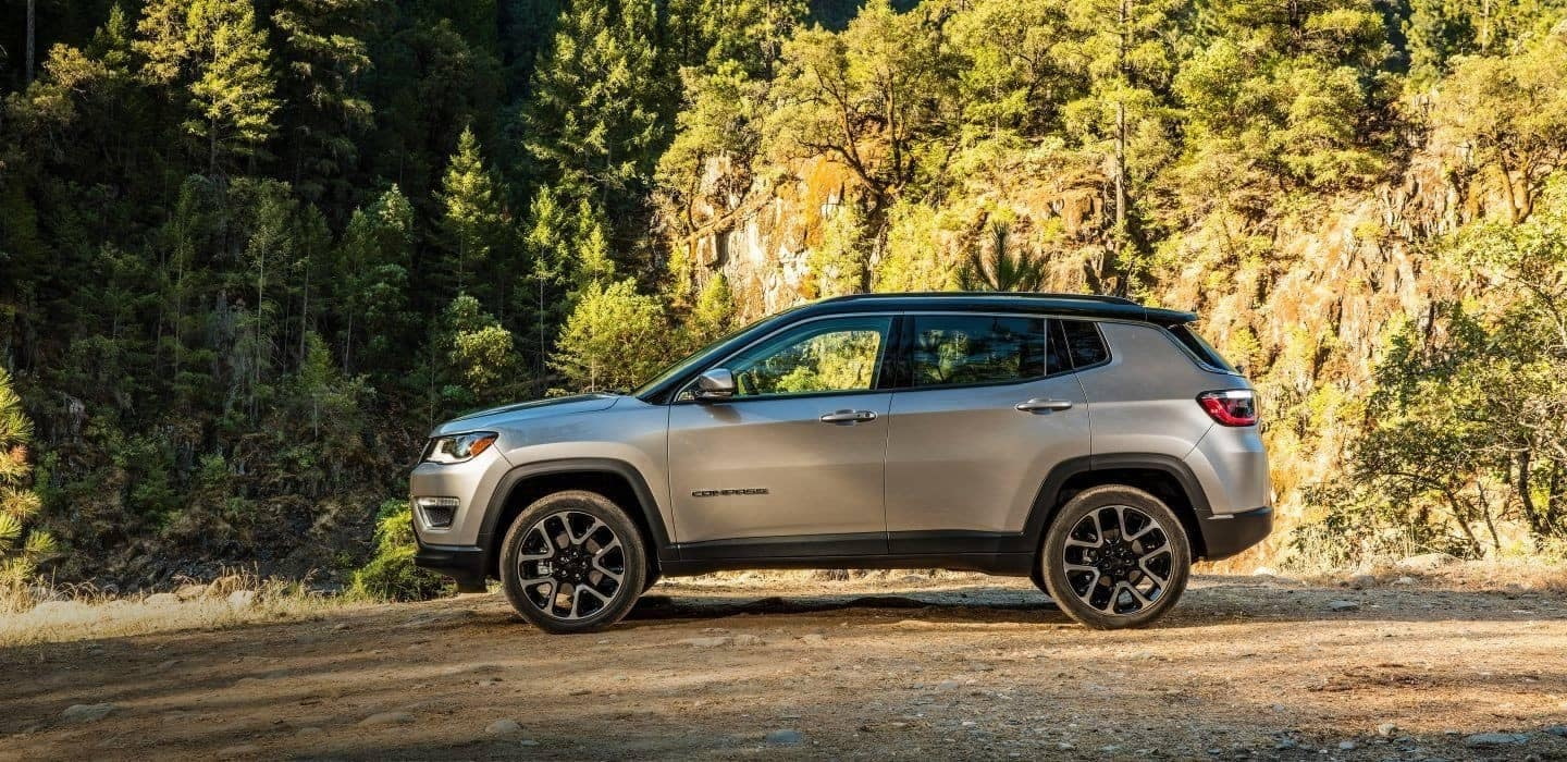 2018 Jeep Compass parked in wooded area