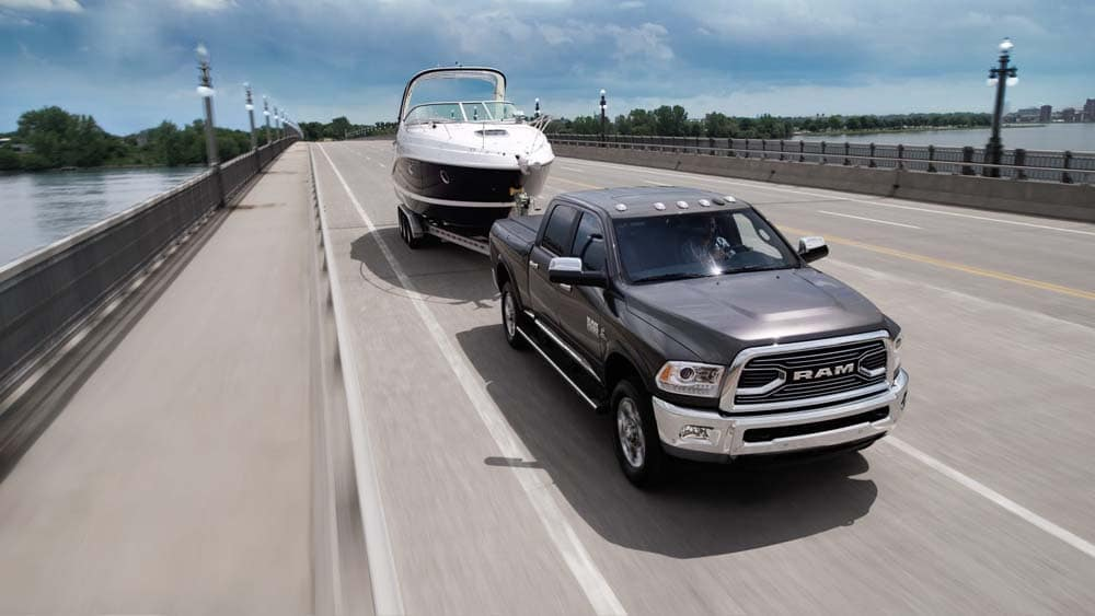 2018 RAM 1500 Limited towing a trailer on the highway