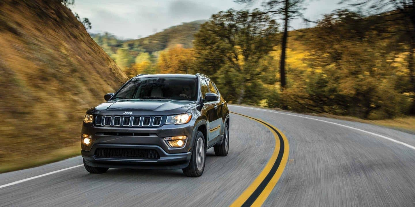 Jeep Compass driving on scenic road