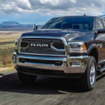 2018 RAM 2500 towing a trailer at full speed along an open road.
