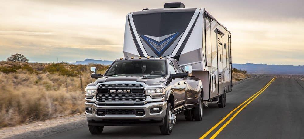 A 2020 RAM 3500 towing an RV trailer