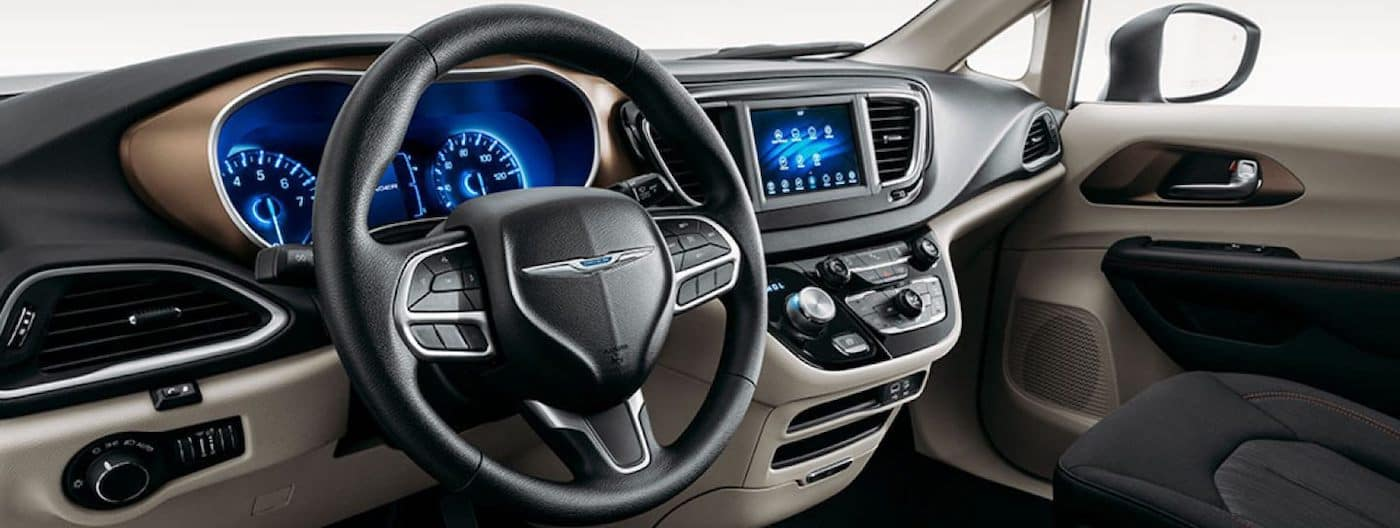 Interior cockpit view of a 2020 Chrysler Voyager with Chrysler Uconnect