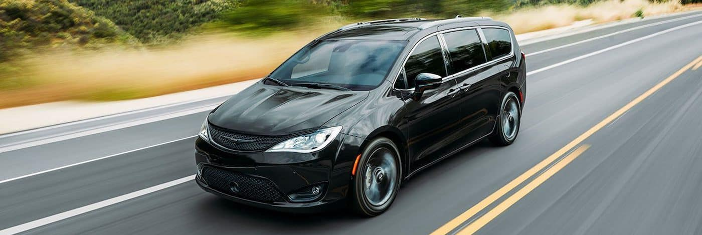 A 2020 Chrysler Pacifica driving on a highway