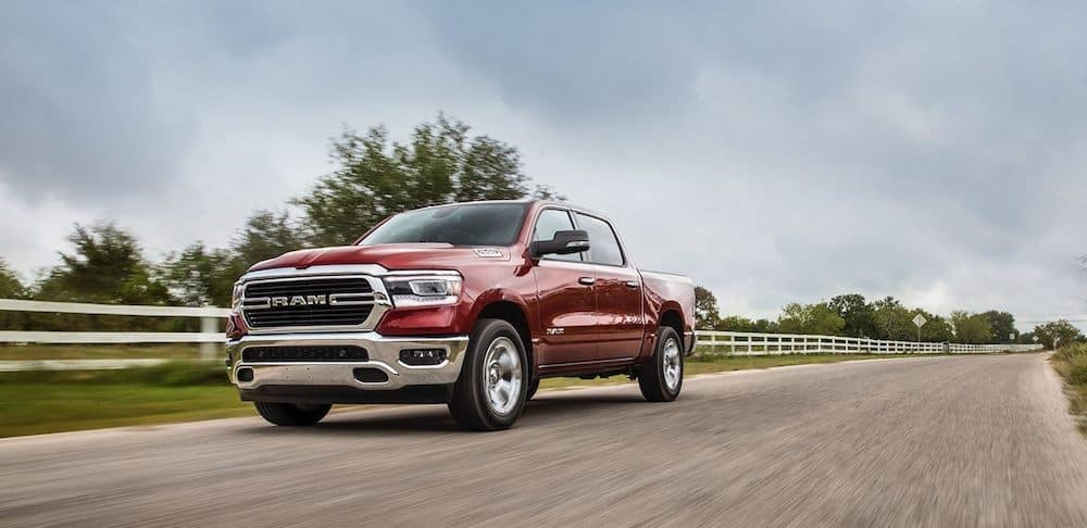 A 2020 RAM 1500 driving on a country road getting excellent fuel efficiency