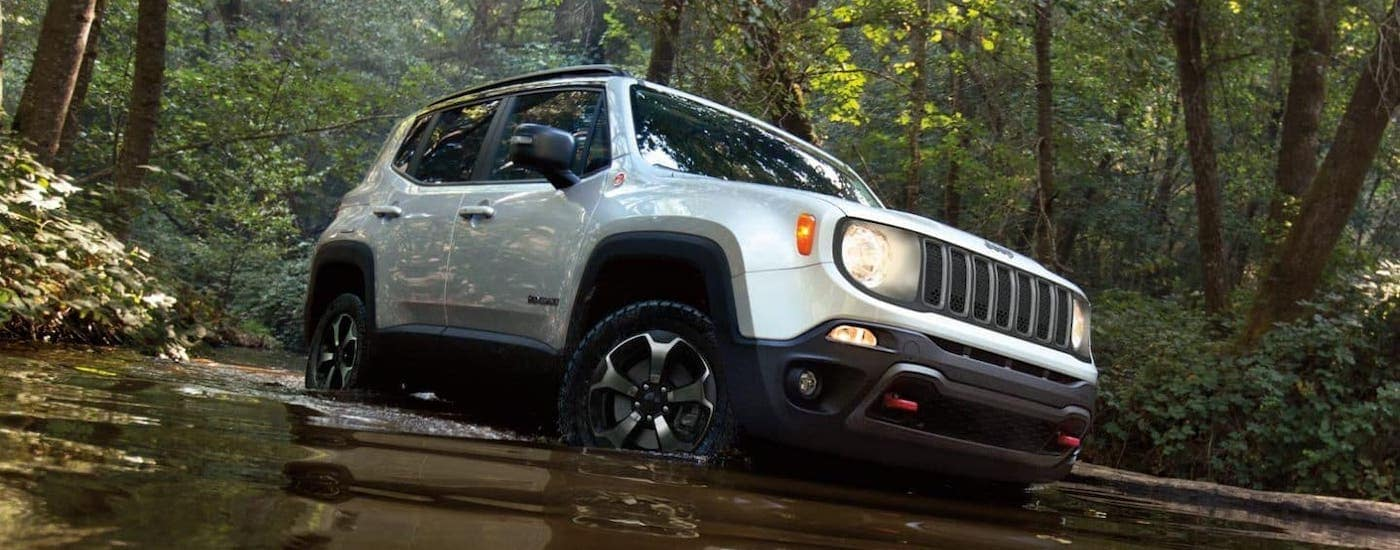 A white 2020 Jeep Renegade is crossing a river near Lexington, KY.