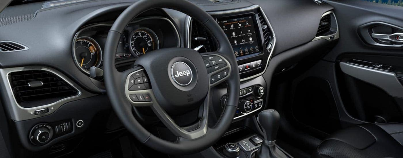 The black interior of a 2020 Jeep Cherokee is shown.