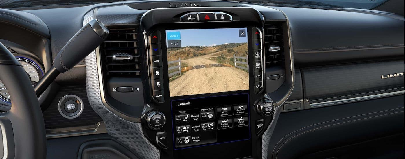 A closeup shows the infotainment and rear camera in a 2020 Ram 2500.