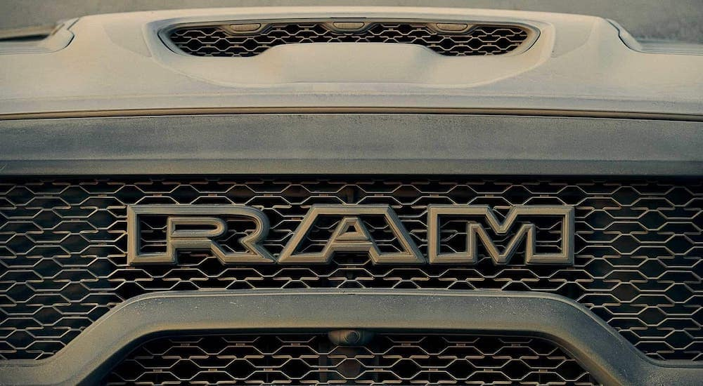 A closeup shows the grille on a new Ram truck, a 2021 Ram 1500 TRX.