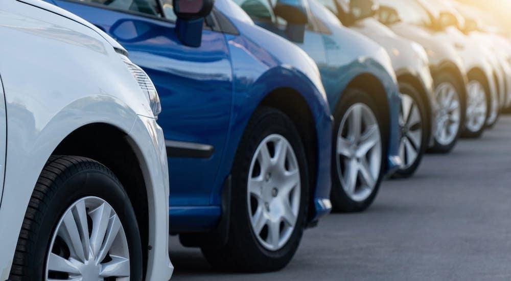 A row of cars are shown at a used car dealership near Lexington, KY.