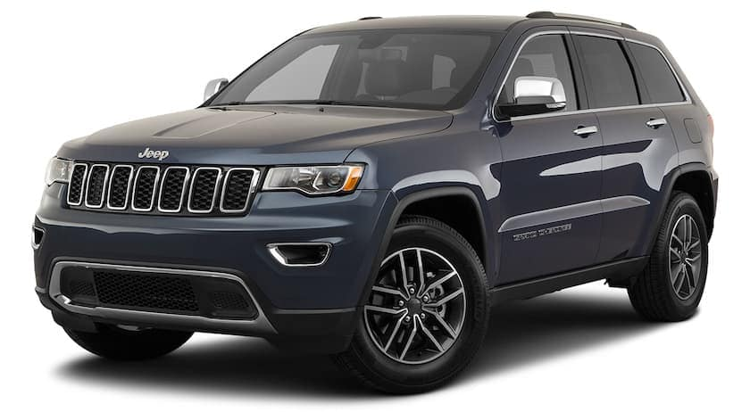 A dark blue 2020 Jeep Grand Cherokee is angled left.
