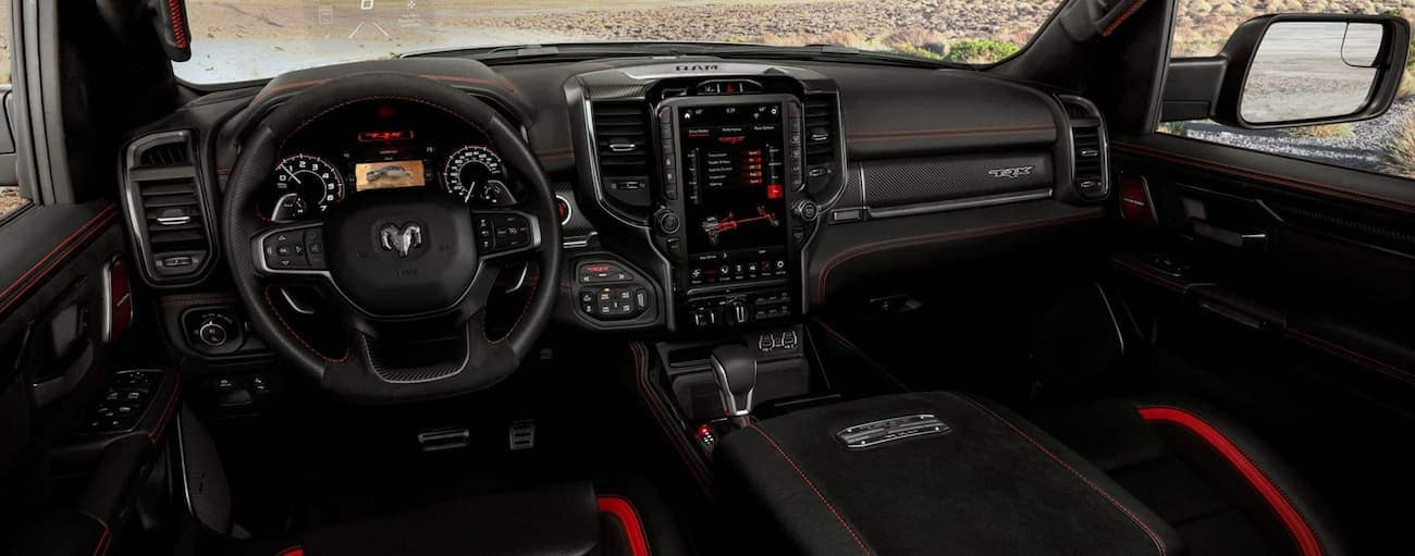 The dashboard and technology features in a 2021 Ram 1500 TRX are shown.