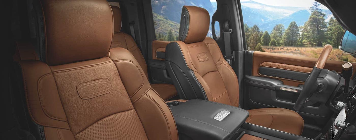 The brown and black leather front seats in a 2020 Ram 3500 Longhorn are shown.