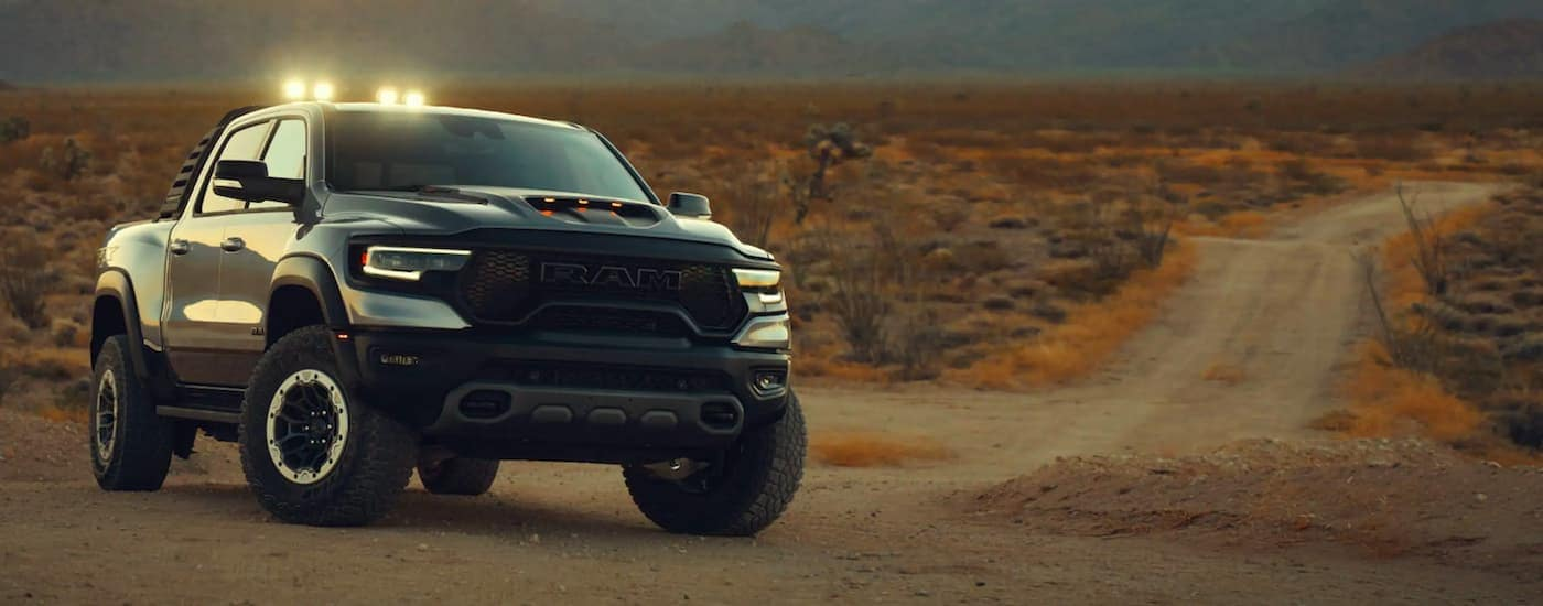 A grey 2021 Ram 1500 TRX is shown parked at the end of a dirt road.