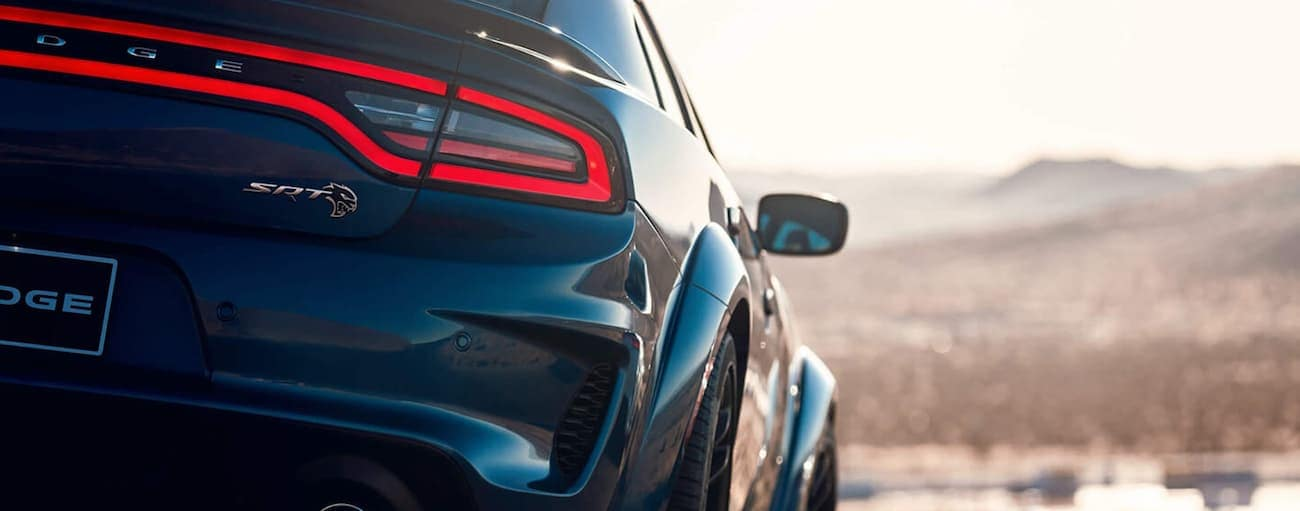 The rear badging on a blue 2020 Dodge Charger SRT is shown.