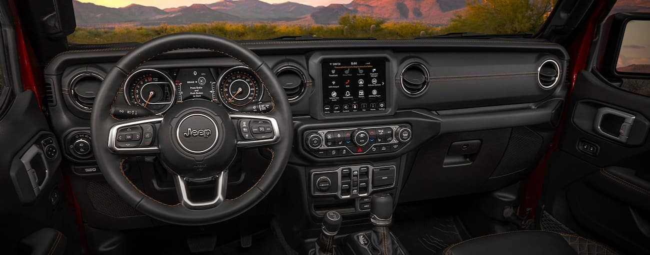 The black dashboard and infotainment screen are shown in a 2021 Jeep Gladiator.