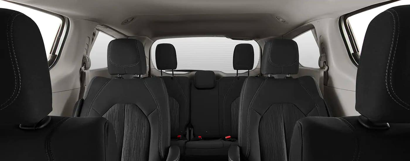 The black interior is shown from the front seats on a 2021 Chrysler Voyager.