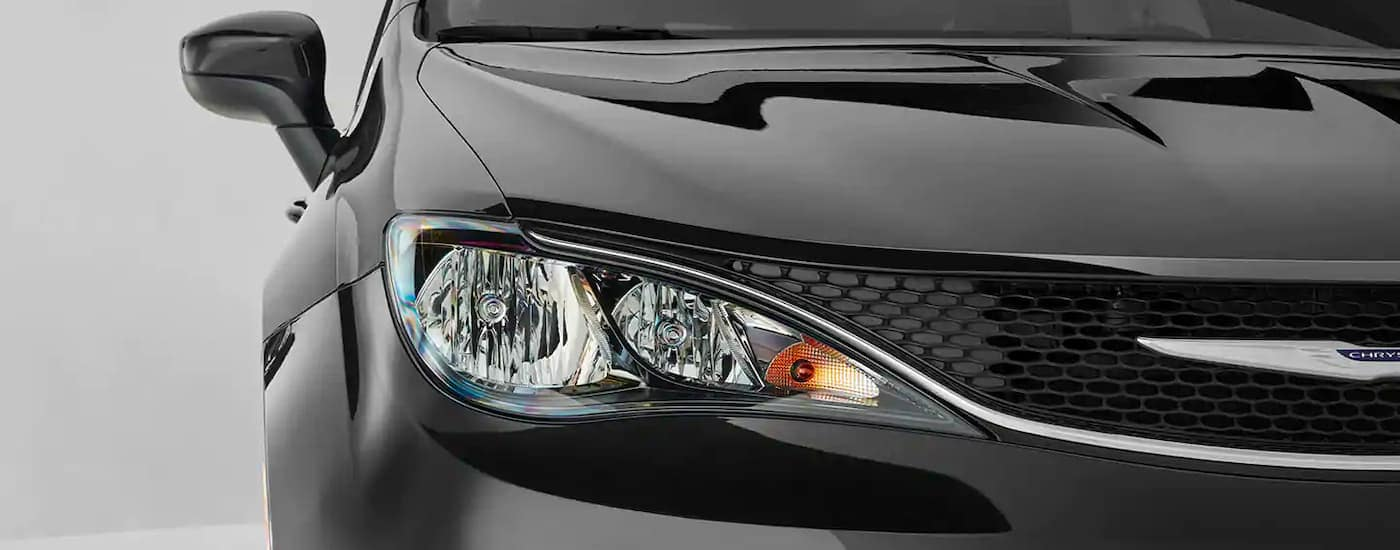 A close up is shown of the passenger headlight on a 2021 Chrysler Voyager.